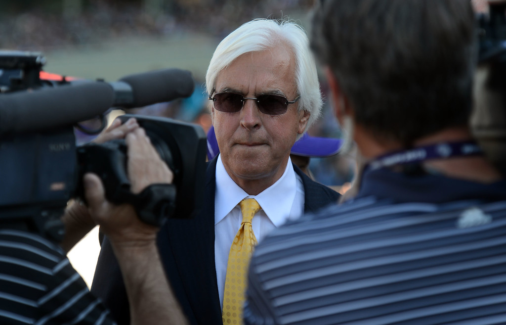 ". Trainer Bob Baffert talks about his Jockey and horse Martin Garcia and  ""New Year\'s Day\"" (not pictured) after winning the Breeders\' Cup Juvenile eighth race during the Breeders\' Cup at Santa Anita Park in Arcadia, Calif., on Saturday, Nov. 2, 2013.    (Keith Birmingham Pasadena Star-News)"