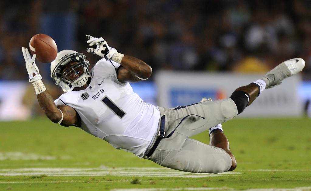 . Nevada WR Brandon Wimberly dives but can\'t hang on to a pass, Saturday, August 31, 2013, at the Rose Bowl. (Michael Owen Baker/L.A. Daily News)