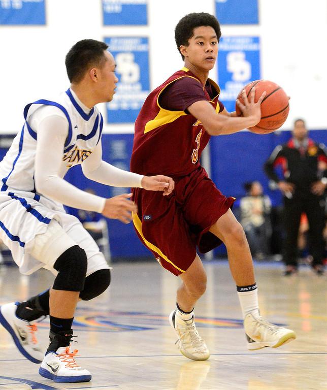 . Wilson\'s Kyle Price (3) carries the ball before passing as Wilson defeats San Dimas 45-43 Friday night, January 10, 2014 at San Dimas High School.  (Photo by Sarah Reingewirtz/Pasadena Star-News)
