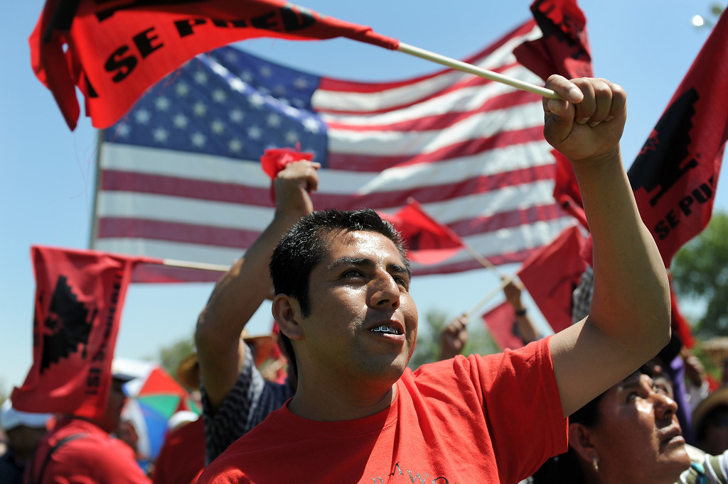 ". Rafael Marquez Amaro cheers at the ""Caravan for Citizenship\"" rally at Yokuts Park in Bakersfield, Wednesday, August 14, 2013. (Michael Owen Baker/L.A. Daily News)"