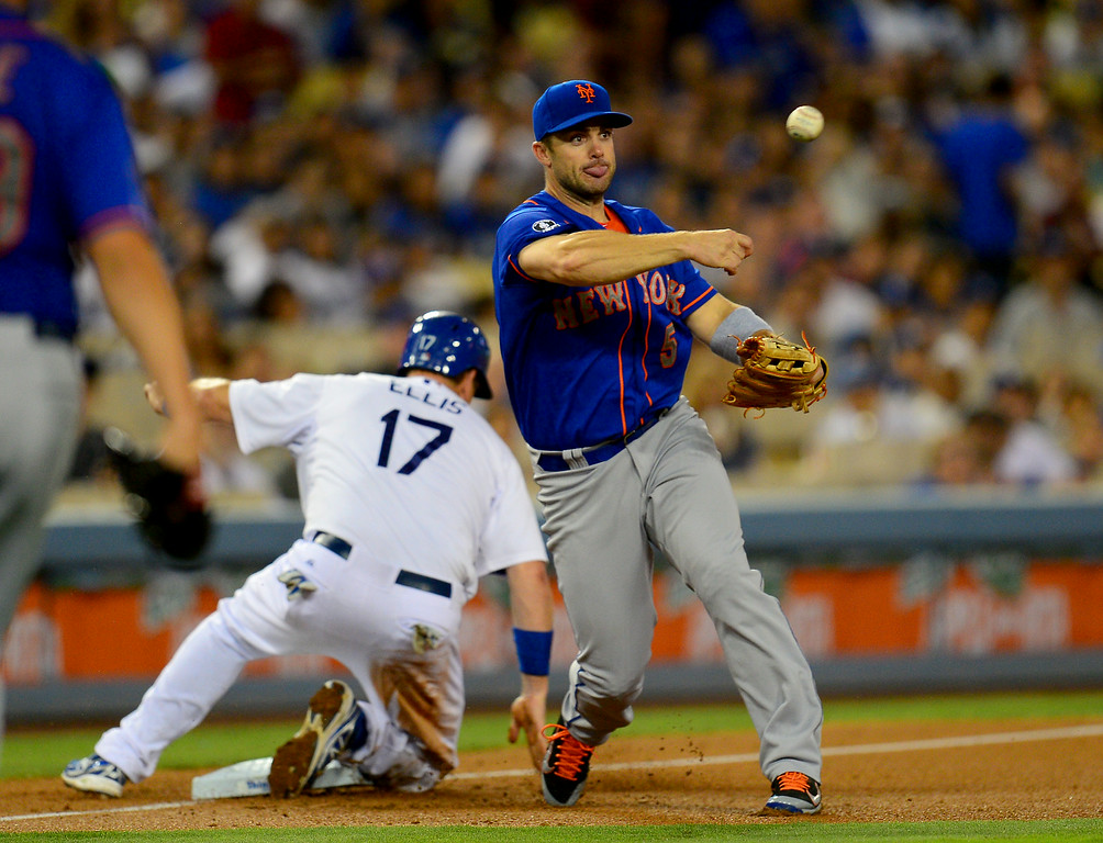 . Mets third baseman David Wright throws to first after forcing out the Dodgers\' A.J. Ellis on a failed sacrifice that turned into a double play. (Photo by Michael Owen Baker/Los Angeles Daily News)