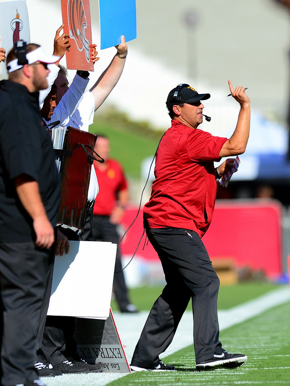 . USC head coach Steve Sarkisian, right, and staff signal the offense, Saturday, August 30, 2014, at the L.A. Memorial Coliseum. (Photo by Michael Owen Baker/Los Angeles Daily News)