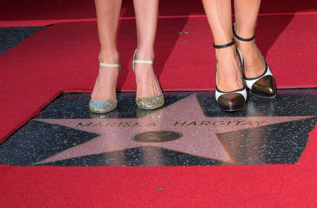 . Actress Hillary Swank (L) and Mariska Hargitay attend a ceremony where Hargitay is honored with a star on the Hollywood Walk of Fame on November 8, 2013 in Hollywood, California.              (JOE KLAMAR/AFP/Getty Images)