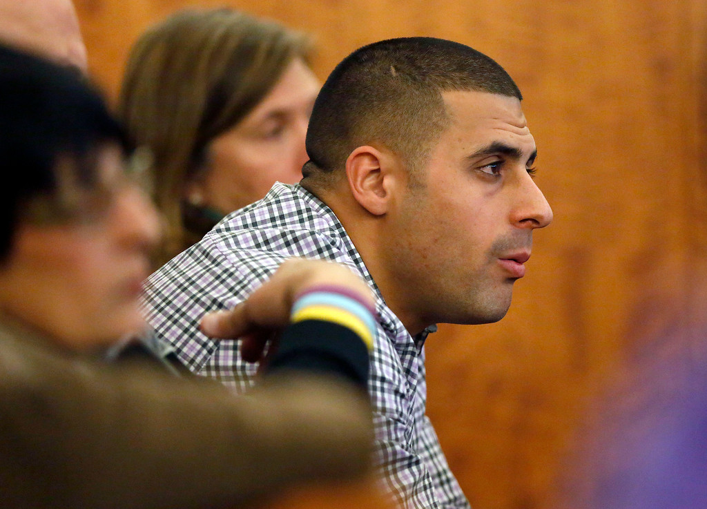 . D.J. Hernandez, right, brother of former New England Patriots NFL football player Aaron Hernandez, watches during his brother\'s murder trial, Thursday, Jan. 29, 2015, in Fall River, Mass. Aaron Hernandez is charged with killing semiprofessional football player Odin Lloyd, 27, in June 2013.  (AP Photo/Steven Senne, Pool)