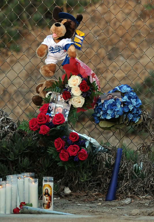 . A make shift memorial for a Man and two children who were killed in a late Thursday night crash along the 3500 block of San Gabriel River Road on Friday, June 14, 2013 in Industry, Calif. Three others were injured in the crash.  (Keith Birmingham/Pasadena Star-News)