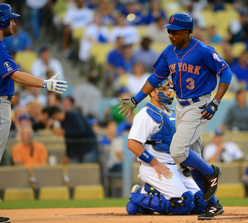 . The Mets Curtis Granderson, right, is congratulated by Daniel Murphy after hitting a leadoff homer in the first inning, Friday, August 22, 2014, at Dodger Stadium. (Photo by Michael Owen Baker/Los Angeles Daily News)