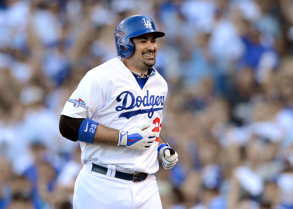 . The Dodgers\' Adrian Gonzalez reacts after hitting his 2nd homerun against the Cardinals in game 5 of the NLCS at Dodger Stadium Wednesday, October 16, 2013.(David Crane/Los Angeles Daily News)