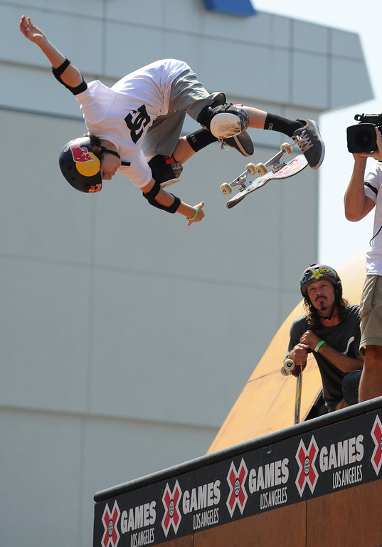 . Tom Schaar falls off his board while Bucky Lasek keeps an eye on the young skater during the Skateboard Vert Finals at L.A. Live in Los Angeles, CA. 8/3/2013(John McCoy/LA Daily News)