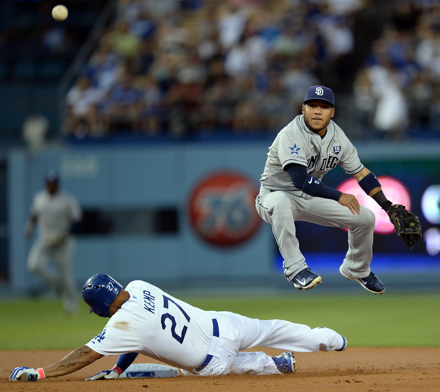 . The Dodgers� Matt Kemp #27 is out at second but breaks up the double play as the Padres� Alexi Amarista #5 throws to first base during their game at Dodger Stadium Thursday, August 21, 2014. (Photo by Hans Gutknecht/Los Angeles Daily News)