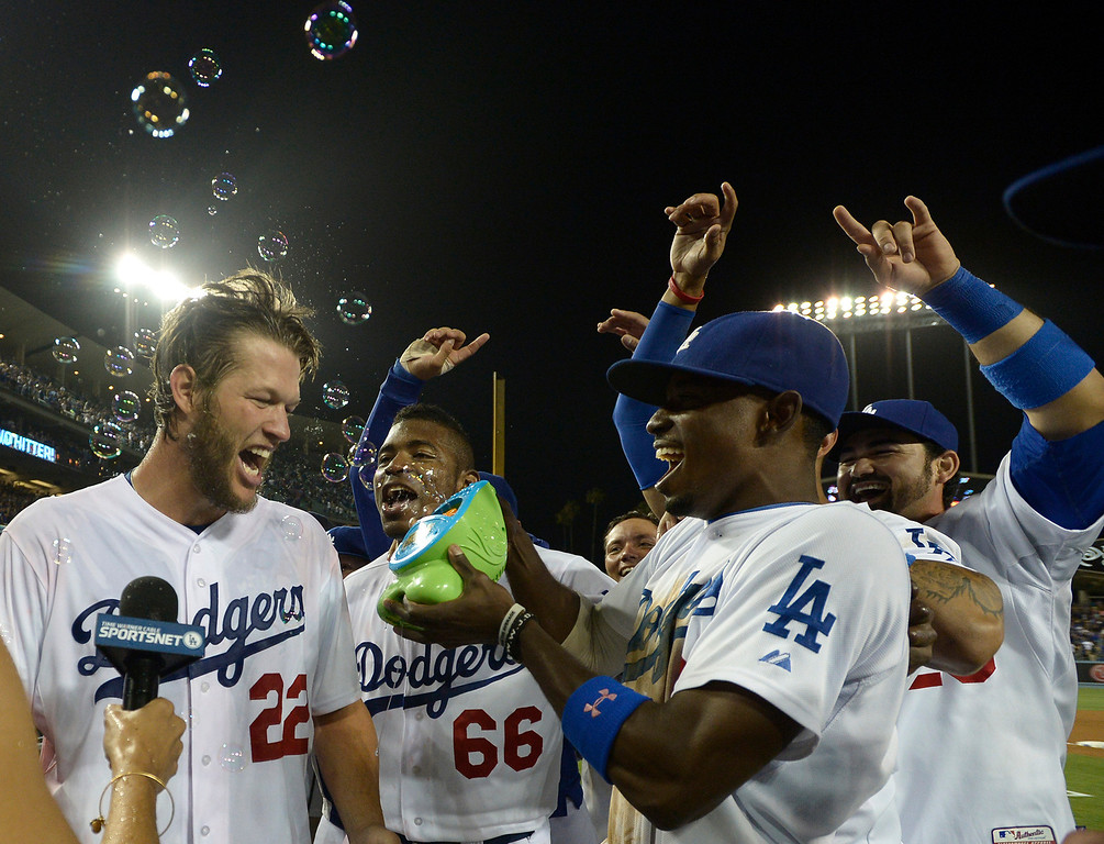 . Yasiel Puig and Dee Gordon bring on the bubbles after Clayton Kershaw throws a no hitter. The Dodgers defeated the Colorado Rockies 8-0 at Dodger Stadium in Los Angeles, CA. 6/18/2014(Photo by John McCoy Daily News)
