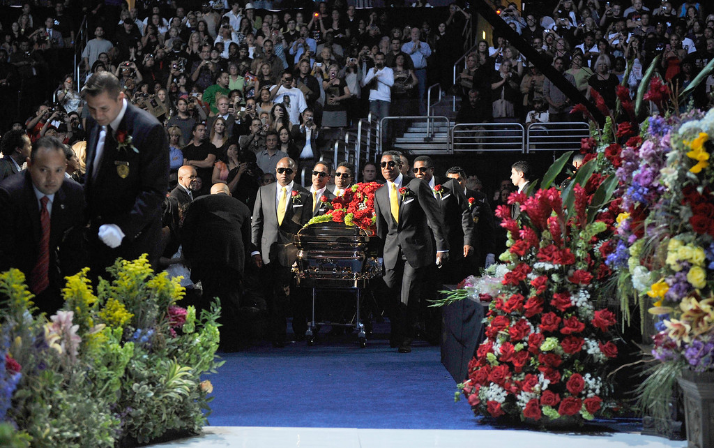 . This photo, provided by the MJ Memorial,  Michael Jackson\'s casket is brought out during public memorial service held at Staples Center on Tuesday, July 7, 2009 in Los Angeles,  (AP Photo/ Harrison Funk, MJ Memorial)