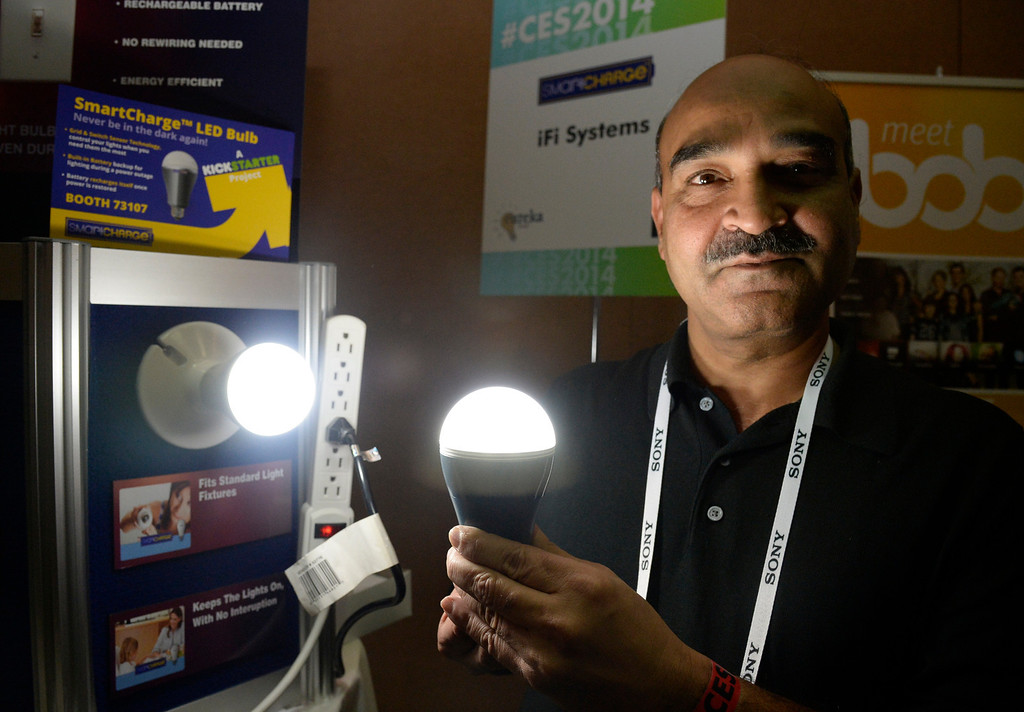 . Shailendra Suman of iFi Systems shows the company\'s smartcharge LED light bulb during the 2014 Consumer Electronics Show (CES) on Sunday, June 5, 2014 in Las Vegas, Nevada. The 2014 CES show starts Tuesday, Jan. 7, 2014 and runs until Friday, Jan. 10, 2014 with 150,000 people estimated to attend the show. (Photo by Gene Blevins/Los Angeles Daily News)