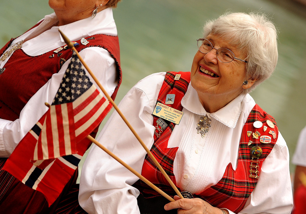 . Margaret Swanson, 81, of Colton, waves both the American and Norwegian flag during a Norway Constitution Day celebration in downtown San Bernardino May 17, 2013.  GABRIEL LUIS ACOSTA/STAFF PHOTOGRAPHER.