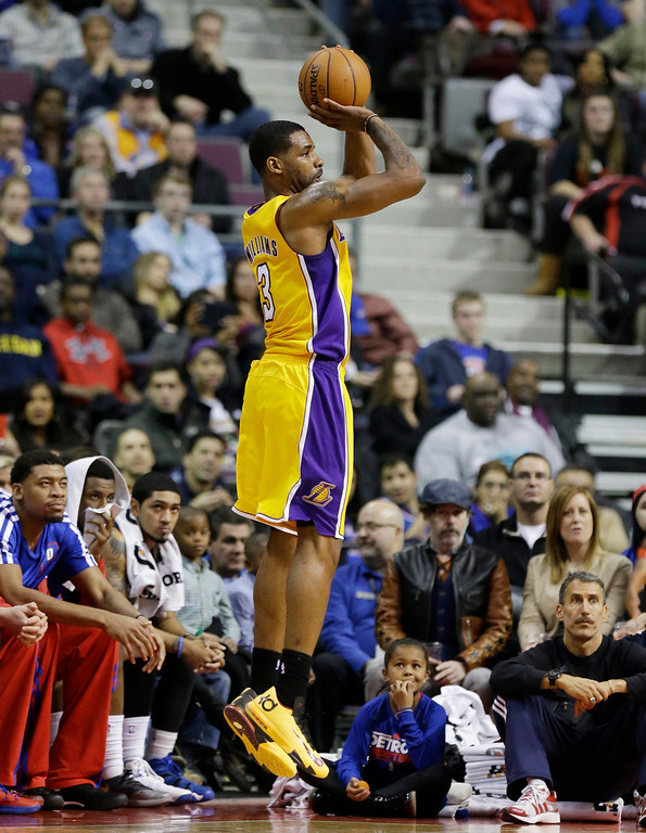 . Los Angeles Lakers forward Shawne Williams (3) shoots from three point range during the second half of an NBA basketball game against the Detroit Pistons at the Palace in Auburn Hills, Mich., Friday, Nov. 29, 2013. (AP Photo/Carlos Osorio)