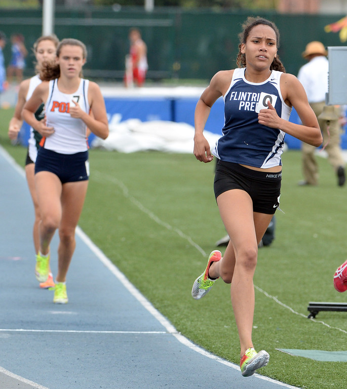 . Flintridge Sarah Yoho competes in the division 4 800 meters race during the CIF Southern Section track and final Championships at Cerritos College in Norwalk, Calif., Saturday, May 24, 2014. 