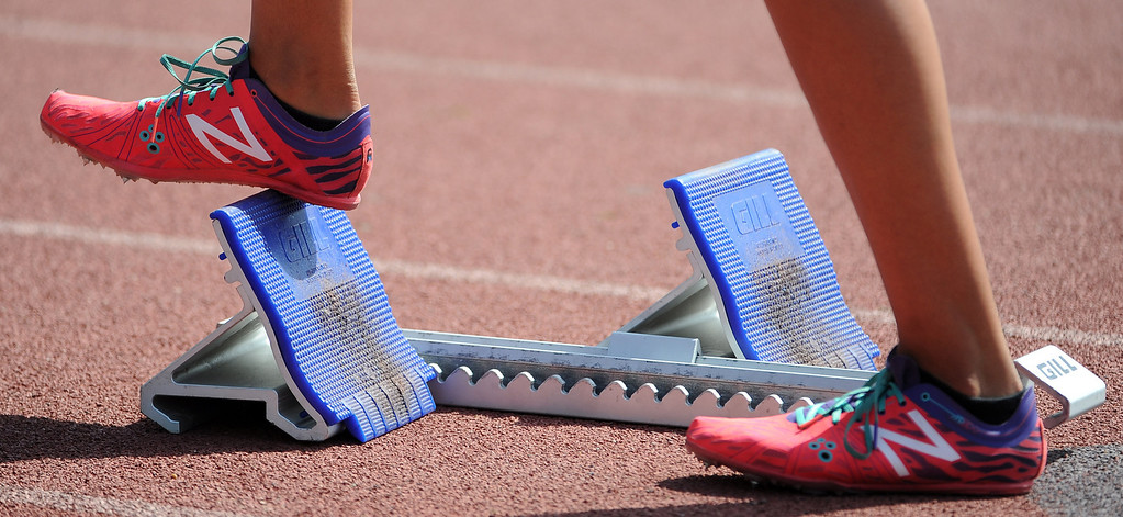 . A athlete checks out her blocks prior to the 4x100 relays during the Hacienda League track finals in Walnut, Calif., on Thursday, May 8, 2014.  (Keith Birmingham Pasadena Star-News)