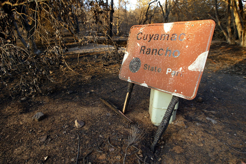 . CUYAMACA RANCHO STATE PARK, CA, NOVEMBER 5:   A charred boundary sign is propped up at Cuyamaca Rancho State Park, which has been closed and may not open until next spring or beyond, on November 5, 2003 in eastern San Diego County. The popular 26.000-acre mountain preserve park burned in the biggest fire in state history, the 280,000-acre Cedar Fire that killed at least 14 people and destroyed thousands of homes. The fire was contained, or surrounded by firelines, yesterday.     (Photo by David McNew/Getty Images)