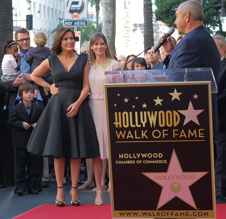 . Actresses Hillary Swank (C) and Mariska Hargitay (L) listen to producer Dick Wolf during a ceremony honoring Hargitay  with a star on the Hollywood Walk of Fame on November 8, 2013 in Hollywood, California.           (JOE KLAMAR/AFP/Getty Images)