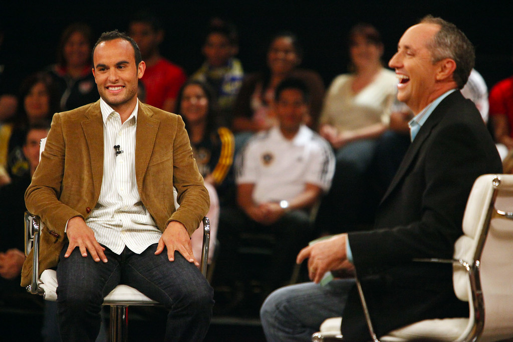 """. Landon Donovan chats with Rick Reilly as they tape a segment for the ESPN show \""""Home Coming with Rick Reilly\"""" in Redlands Monday, April 19, 2010 at Redlands East Valley High School where Donovan was a student. Donovan, now a professional soccer player with the Los Angeles Galaxy, was a paper boy for the Redlands Daily Facts when he was a young teenager. (Staff file photo/Redlands Daily Facts)"""