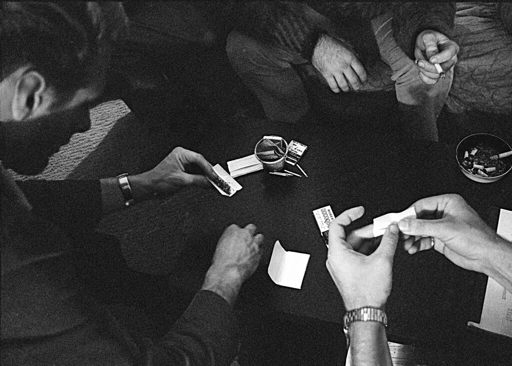 """. FILE - In this May 23, 1966, file photo, people roll joints at a marijuana party near the University of California at Berkeley campus in Berkeley, Calif. In 2012, Washington state and Colorado voted to legalize and regulate its recreational use. But before that, the plant, renowned since ancient times for its strong fibers, medical use and mind-altering properties, was a staple crop of the colonies, an \""""assassin of youth,\"""" a counterculture emblem and a widely accepted - if often abused - medicine. On the occasion of  �Legalization Day,� Thursday, Dec. 6, 2012, when Washington�s new law takes effect, AP takes a look back at the cultural and legal status of the �evil weed� in American history. (AP Photo/File)"""