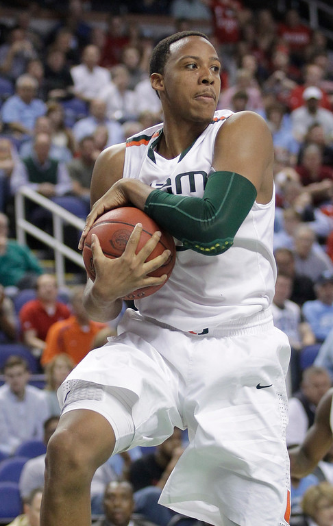 . <b>Kenny Kadji</b> <br />Forward-center, 6-11, 242. Averaged 12.9 points, 6.8 rebounds and 1.3 blocks as a senior last year at Miami. Shot 47.1 percent and hit 47 3-pointers at a 35.1 percent clip. Great NBA body and already 25, but defensive rebounding is major concern.(AP Photo/Bob Leverone)