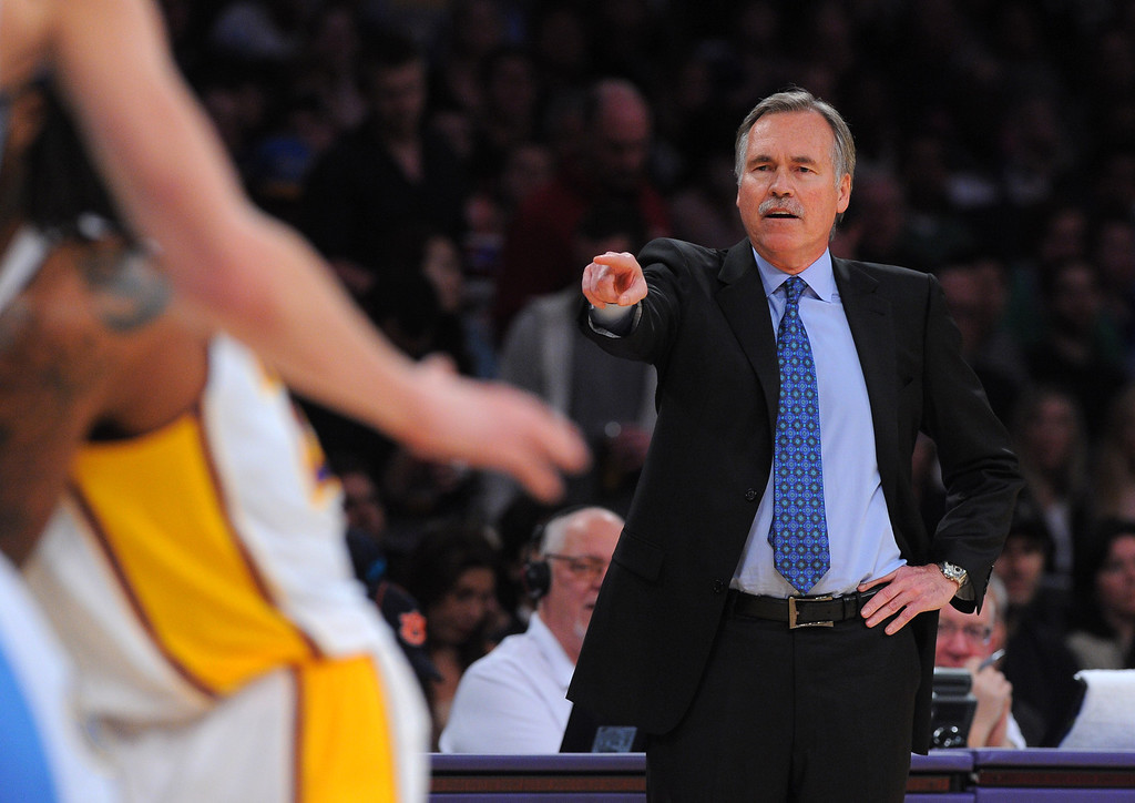. Lakers coach Mike D\'Antoni makes a call to his players against the Nuggets at the Staple Center in Los Angeles, CA on Sunday, January 5, 2014. 1st half. 