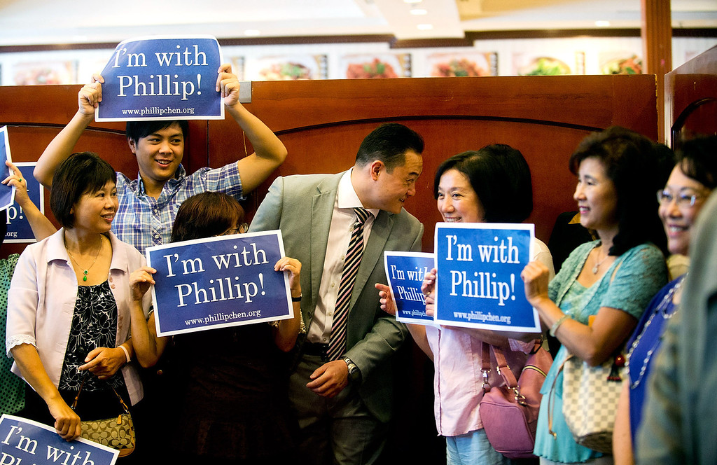 . Phillip Chen mingles with his supporters during his campaign announcement at Seafood Village Restaurant in Rowland Heights on Thursday, July 8, 2013. The Walnut Valley school board member is running in the 55th Assembly district currently represented by Assemblyman Curt Hagman, who is not running for reelection due to term limits. (SGVN/Staff photo by Watchara Phomicinda)