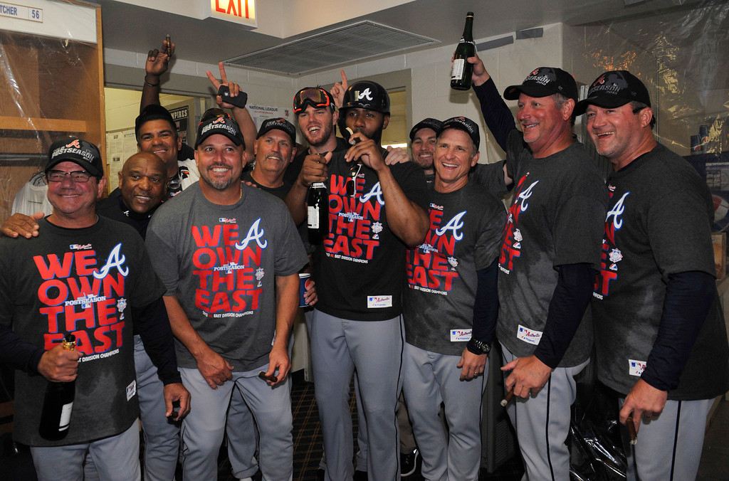 . CHICAGO, IL - SEPTEMBER 22:  The Atlanta Braves celebrate their  National League East Championship on September 22, 2013 at Wrigley Field in Chicago, Illinois. The Atlanta Braves defeated the Chicago Cubs 5-2 to clinch the National League East Championship.  (Photo by David Banks/Getty Images)