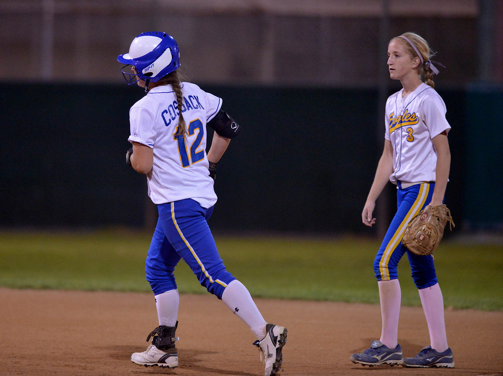 . 05-03-2013-(LANG Staff Photo by Sean Hiller)-  El Segundo vs. Agoura in the El Segundo softball tournament final Saturday night at Recreation Field in El Segundo. Maddy Cossack jogging the base past El Segundo\'s Rhianna Rich after hitting a home run for Agoura.