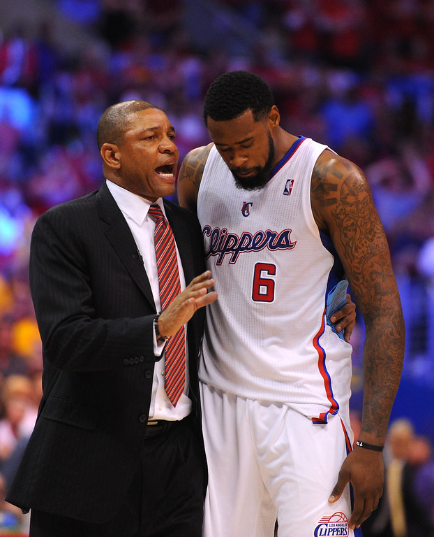 . Clippers coach Doc Rivers talks with DeAndre Jordan. (Photo by Michael Owen Baker/L.A. Daily News)