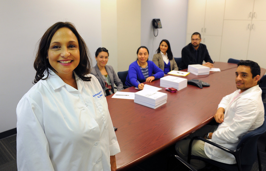 . Dr. Michelle Bholat, executive director for UCLA\'s International Medical Graduate Program, left, with a group of doctors from Latin American, Wednesday, April 16, 2014, at the UCLA Family Health Center. They are from left, Alanna Chig, Carla DeLeon, Aichel Nateras, Jorge Otañez and Hamlet Garcia Peña. (Photo by Michael Owen Baker/L.A. Daily News)