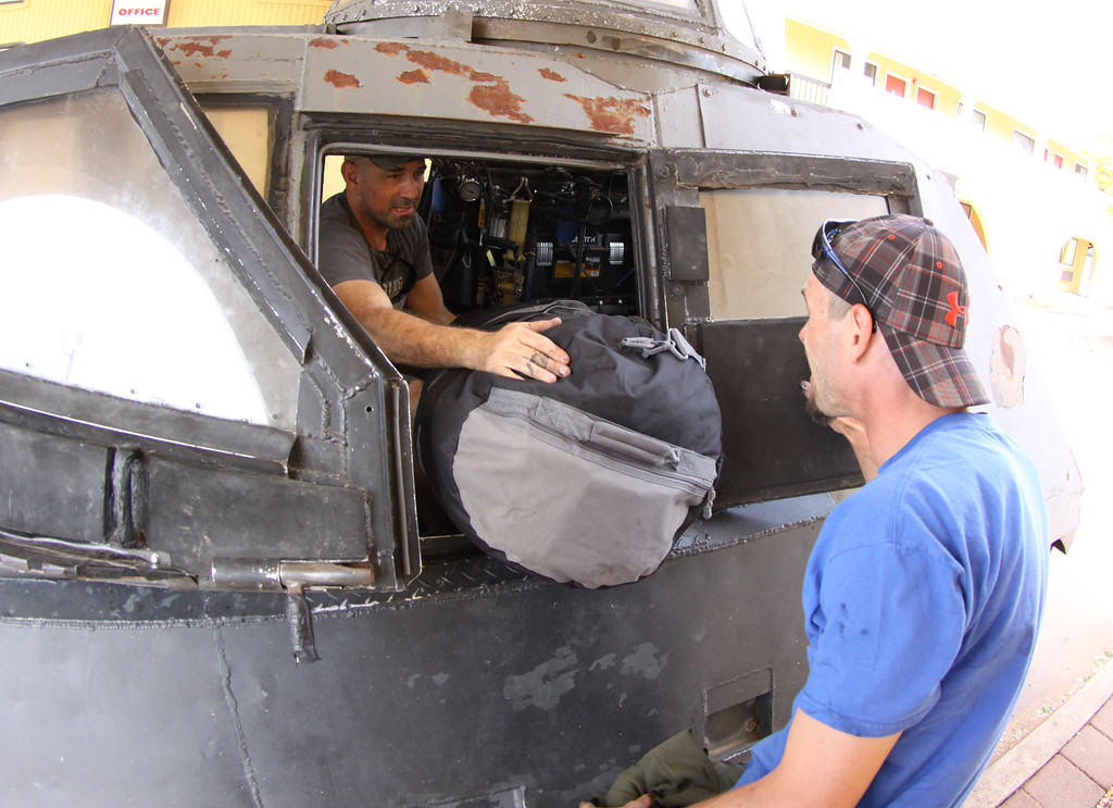. Sean Casey(L) IMAX film-maker/Storm Chaser with TIV-2 (Tornado Intercept Vehicle) and driver Jonathon Morrison as they get ready to start on another tornado IMAX film with the National Geographic in El Reno, Oklahoma Friday April 25,2014.April  26,2014. Photo by Gene Blevins