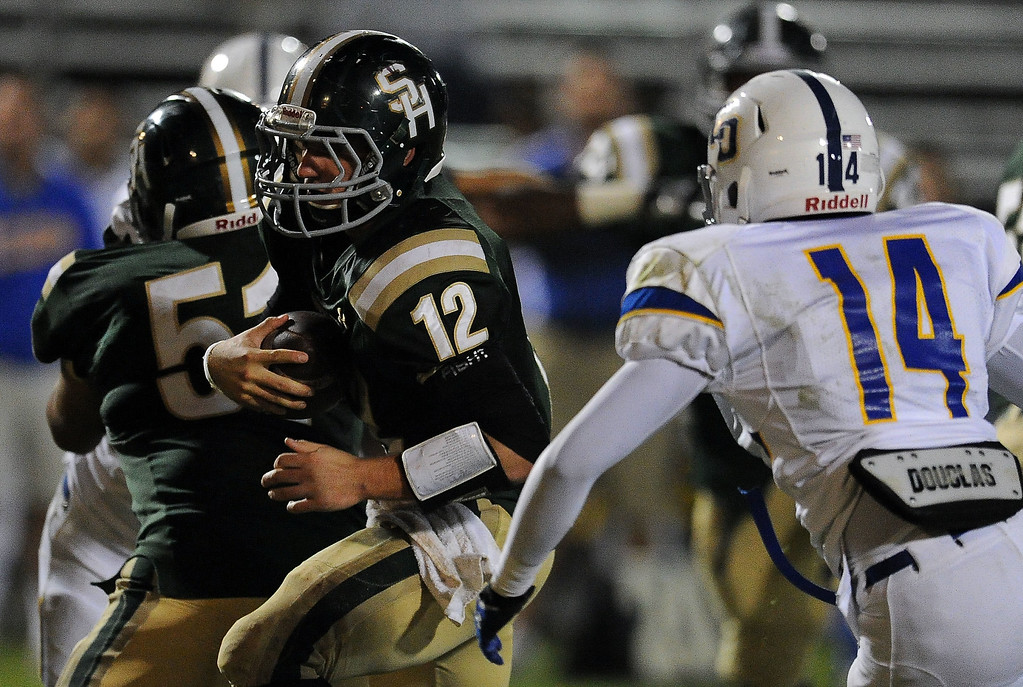 . South Hills quarterback Adam Goss (12) runs for yardage past Charter Oak\'s Aaron Akins (14) in the second half of a prep football game at Covina DIstrict Field in Covina, Calif., on Thursday, Oct. 24, 2013. 