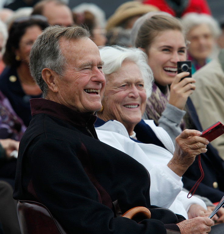 . Former President George H. W. Bush, left, joined by former First Lady Barbara Bush, center, and granddaughter, Lauren Bush, right,  listen  Wednesday, Sept. 30, 2009 during a ceremony to unveil a Navy anchor and plaque  in honor of Bush at an turnout that overlooks Bush\'s Walker\'s Point coastal estate. The 6,000 pound anchor and plaque were given by a group of neighbors and friends to thank him for his service as president and for being a good neighbor. (AP Photo/Joel Page)