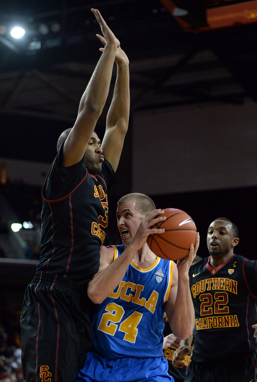 . Southern California\'s D.J. Haley (33) defends against UCLA\'s Travis Wear (24) in the first half of a PAC-12 NCAA basketball game at Galen Center in Los Angeles, Calif., on Saturday, Feb. 8, 2014. (Keith Birmingham Pasadena Star-News)