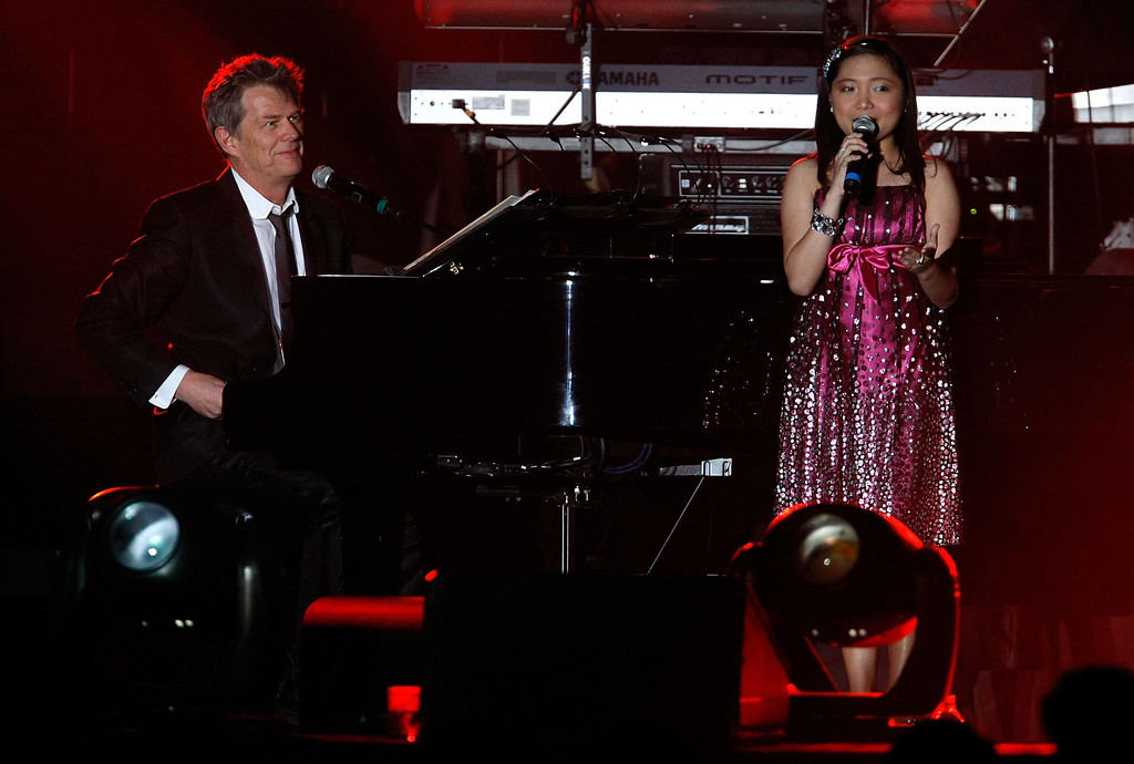 . LAS VEGAS - OCTOBER 11:  Singer Charice Pempengco (R) and producer/composer David Foster perform at the 13th annual Andre Agassi Charitable Foundation\'s Grand Slam for Children benefit concert at the Wynn Las Vegas October 11, 2008 in Las Vegas, Nevada.  (Photo by Ethan Miller/Getty Images)