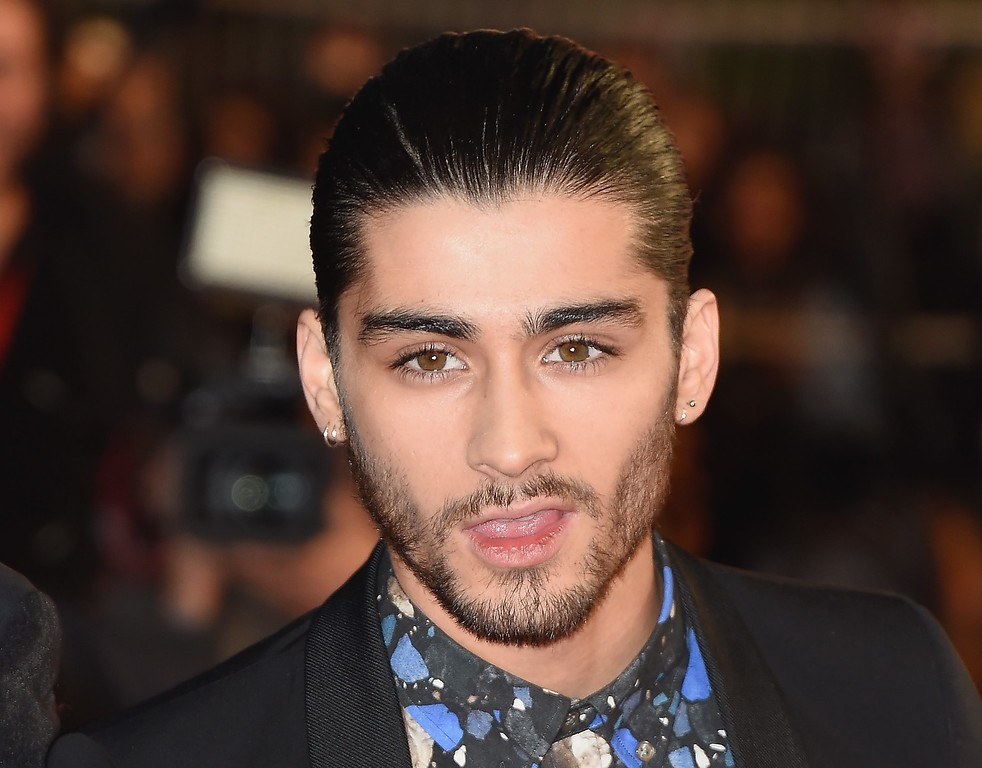 ". One Direction member Zayn Malik attends the NRJ Music Awards at Palais des Festivals on December 13, 2014 in Cannes, France.  The chart-topping boy band ""One Direction\"" says Zayn Malik has left the group.  (Photo by Pascal Le Segretain/Getty Images)"