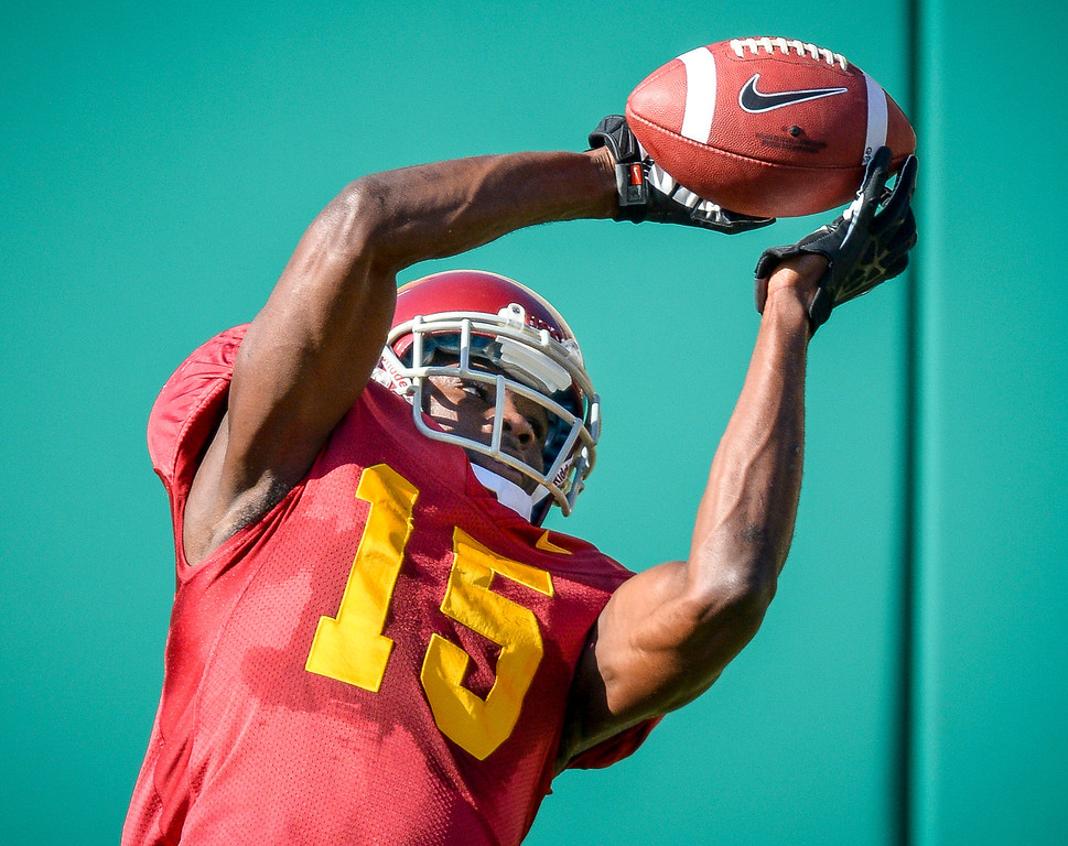 . USC�s Nelson Agholor pulls a pass during spring practice at USC Tuesday, April 15, 2014.  (Photo by David Crane/Los Angeles Daily News.)