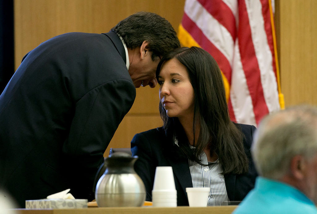 . Prosecutor Juan Martinez whispers ion the ear of Dr. Janeen DeMarte an expert witness for the prosecution during the Jodi Arias trial at Maricopa County Superior Court in Phoenix on Tuesday, April 16, 2013. Defense attorneys rested their case Tuesday after about 2 1/2 months of testimony aimed at portraying Arias as a domestic violence victim who fought for her life the day she killed her one-time boyfriend.  (AP Photo/The Arizona Republic, David Wallace, Pool)