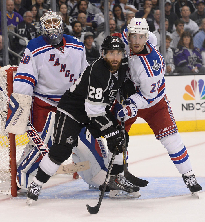 . Kings Jarret Stoll and Rangers Ryan McDonagh fight for position in front of Rangers goalie Henrik Lundqvist in the 3rd period. The Los Angeles Kings faced the New York Rangers in game 1 of the Stanley Cup Finals. Los Angeles, CA. 6/4/2014(Photo by John McCoy / Los Angeles Daily News)