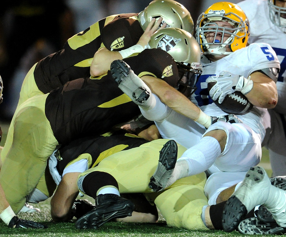 . St. Francis defense stops La Mirada\'s Adam Carrasco (C) (5) for a loss of yards in the first half of a prep football game at St. Francis High School in La Canada, Calif. on Thursday, Sept. 19, 2013.    (Photo by Keith Birmingham/Pasadena Star-News)