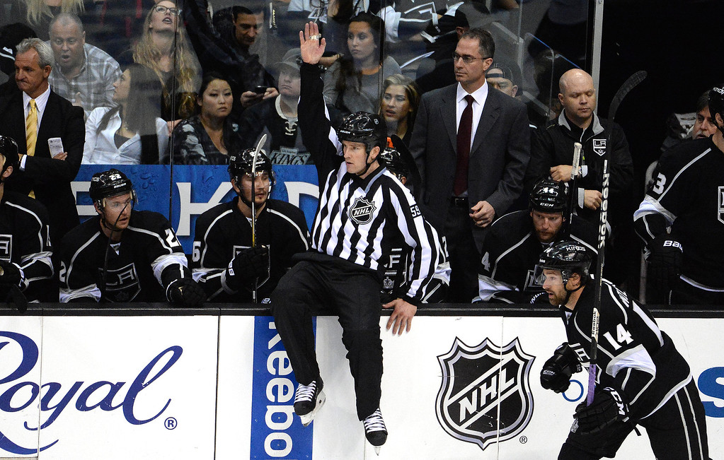 . An official jumps on the boards to make a call during the third period in Game 4 of an NHL hockey first-round playoff series between the San Jose Sharks and the Los Angeles Kings at Staples Center in Los Angeles on Thursday, April, 24  2014. Los Angeles Kings won 6-3. (Keith Birmingham Pasadena Star-News)