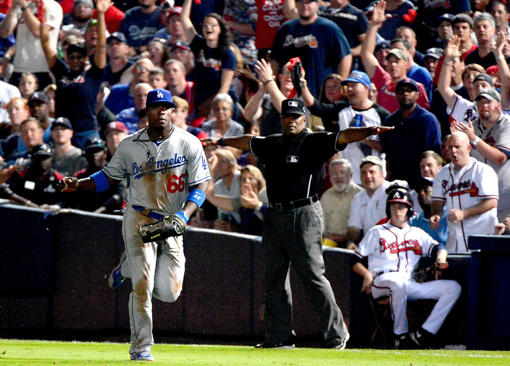 . Los Angeles Dodgers\' Yasiel Puig attempts to make an out at first as they play the Atlanta Braves in the first game of the playoffs Thursday, October 3, 2013 at Turner Field in Atlanta, Georgia. (Photo by Sarah Reingewirtz/Pasadena Star- News)