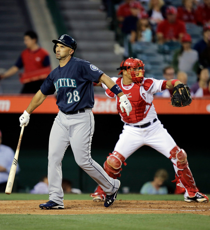 . Seattle Mariners\' Raul Ibanez walks toward the dugout after striking out during the fourth inning of a baseball game in Anaheim, Calif., Tuesday, June 18, 2013. (AP Photo/Jae C. Hong)