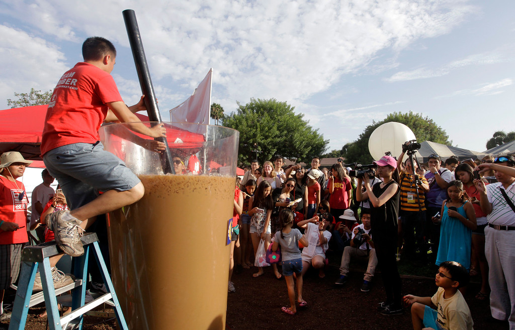 . Albert Chu, 24, stirs his 320 gallon creation, the world\'s largest boba cup, at the 626 night market at Santa Anita Park in Arcadia, Saturday August 3, 2013. (SGVN/Correspondent Photo by Ron Fu/SVCITY)