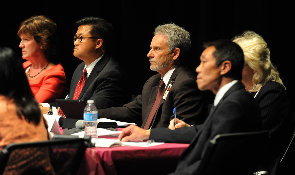 . Board members listen to speaks as over 200 people crowded the Arcadia Unified School District Performing Arts Center as a show of support for fired Arcadia High School cross-country coach James O\'Brien during a Arcadia Unified School District Board of Education meeting on Tuesday, July 23, 2013 in Arcadia, Calif. O\'Brien, led the team to two time state and national championships.