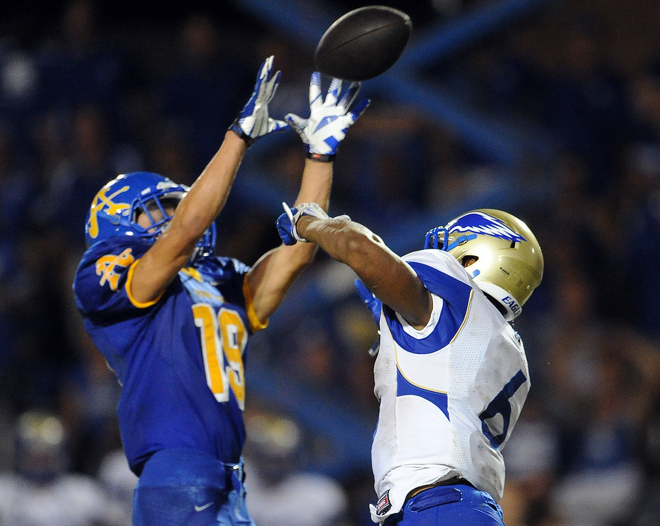. Bishop Amat\'s Adrian Ortega (19) intercepts a pass intended for Santa Margarita\'s Jeremy McNichols (6) in the second half of a prep football game at Bishop Amat High School on Friday, Aug. 30, 2013 in La Puente, Calif. Bishop Amat won 38-28.   (Keith Birmingham/Pasadena Star-News)