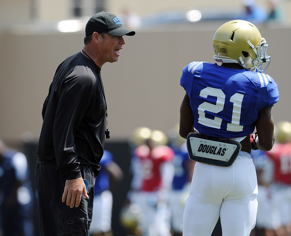 . UCLA head coach Jim Mora during football practice at Spaulding Field on the UCLA campus Saturday April 12, 2014. (Photo by Hans Gutknecht/Los Angeles Daily News)