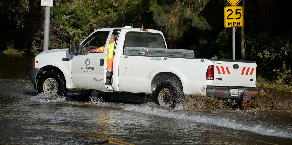 . July 29,2014. Westwood CA,  A DWP truck almost got stuck in the mud after a major water main break sent a geyser of water blasting through Sunset Boulevard north of the UCLA campus Tuesday, sending mud and water cascading down the street and inundating a number of vehicles as it made its way onto the campus. Photo by Gene Blevins/LA DailyNews