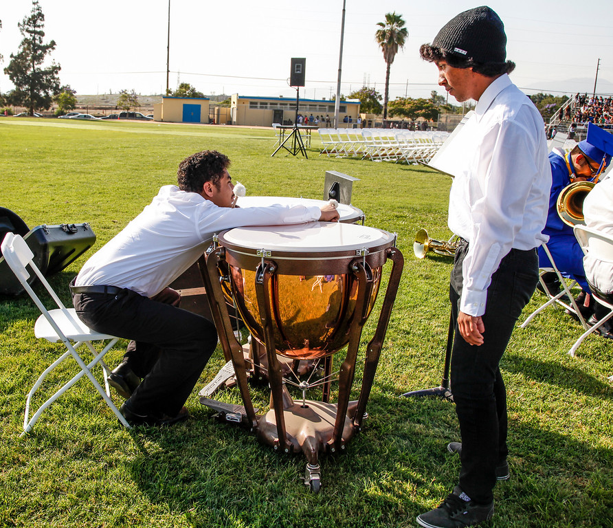 . Waiting for the graduation processional to begin, Poly High School band members, Roy Garcia and Humberto Mejia relax on the football field, at John H Francis Polytechnic High School, Sun Valley, Calif., June 7, 2013. Photo: Lynn Levitt.